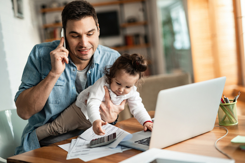 Man working from home with child